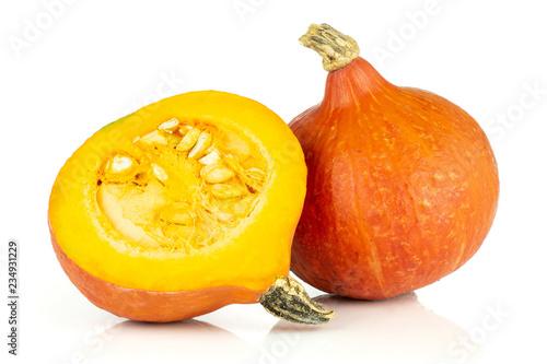 Photo  Group of one whole one half of fresh red kuri pumpkin hokkaido variety with seed