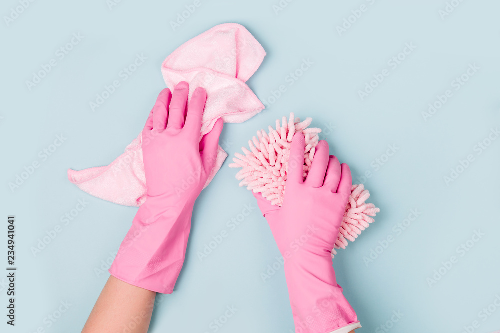 Fototapety, obrazy: Female hands cleaning on blue background. Cleaning or housekeeping concept background. Copy space.  Flat lay, Top view.