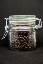 Jar Of Pepper On A Black Background