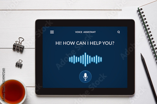 Obraz Voice assistant concept on tablet screen with office objects - fototapety do salonu