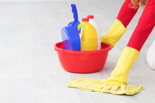 Hand With Cleaning Products Sc...
