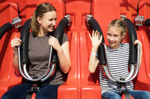 Mom And Daughter Are Sitting O...