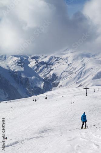 Skier descend on snowy ski slope