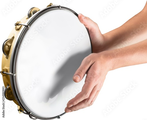 Fotografia Male hands Playing the drum isolated on white background