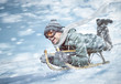 canvas print picture - Mann in voller Fahrt beim Rodeln im Schnee