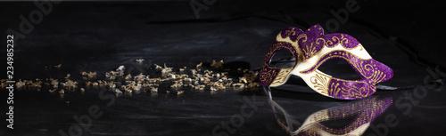 Fotografia Carnival mask on black background, reflections, banner