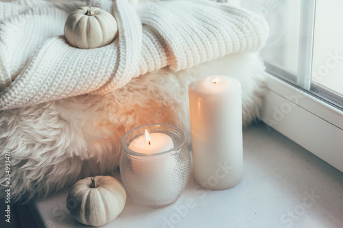 Photo Stands Autumn Hygge scene with sweater and candles
