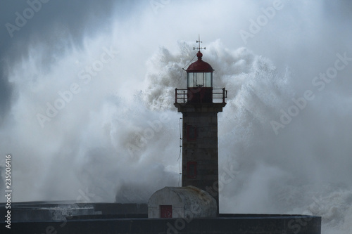 Poster Gris Big storm with big waves near a lighthouse
