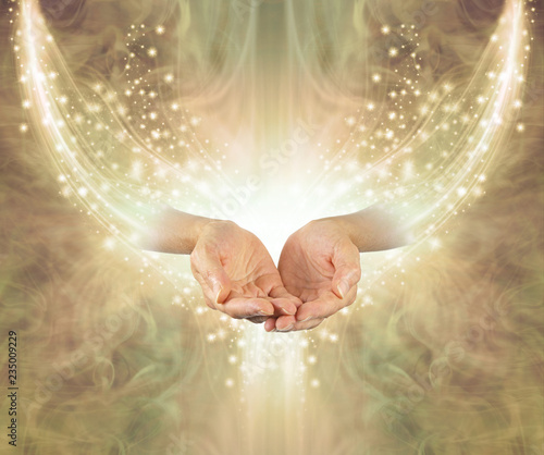 Golden Healing Resonance  - female cupped hands emerging from arc of shimmering sparkles on a glowing golden ethereal energy formation background with copy space