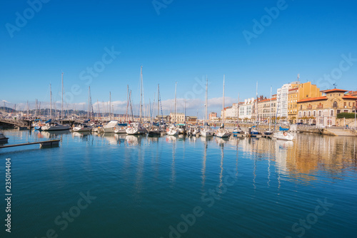 City on the water Gijon cityscape. Yatchs in marina port of Gijon, Asturias, Spain.