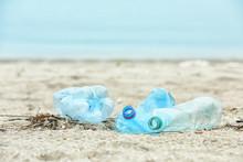 Used Plastic Bottles On Beach,...