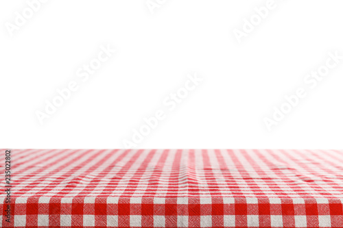 Empty table covered with napkin against white background