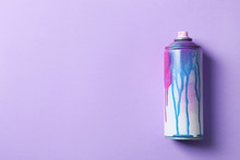 Used Can Of Spray Paint On Color Background, Top View. Space For Text
