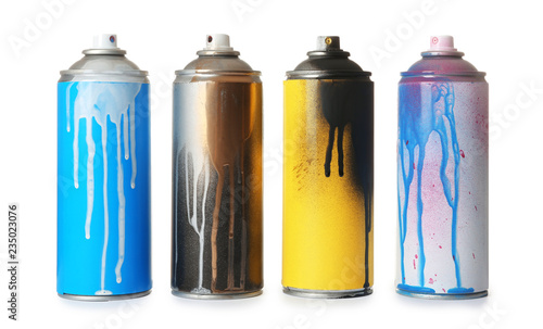 Foto Used cans of spray paint on white background