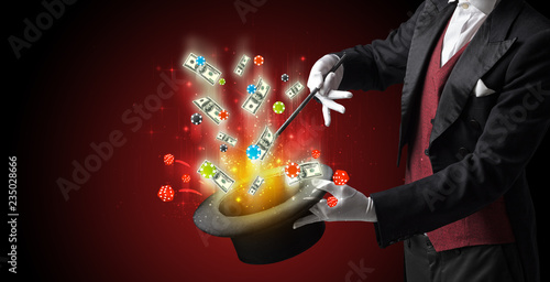 Foto  Illusionist conjure with magic wand gambling things from a cylinder