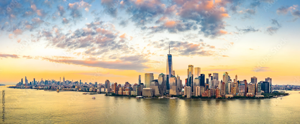 Fototapeta Aerial panorama of New York City skyline at sunset with both midtown and downtown Manhattan