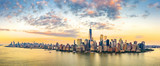 Fototapeta New York - Aerial panorama of New York City skyline at sunset with both midtown and downtown Manhattan