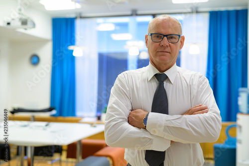 Fototapety, obrazy: Handsome Senior Businessman With Arms Crossed In The Office