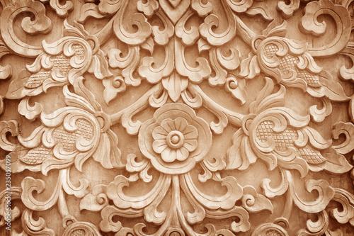 Valokuva  Pattern of flower carved on wood background