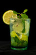 Mojito Cocktail with rum, brown sugar, lemon juice, mint and soda water