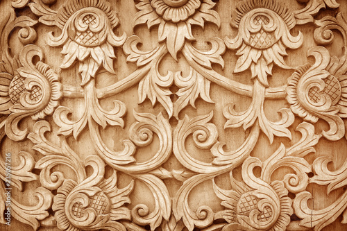 Pattern of flower carved on wood background Canvas-taulu