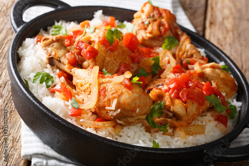Haitian stewed Chicken (poulet creole) with rice closeup. horiontal