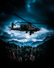 Heavy Armed Attack Helicopter Flies Over Hills