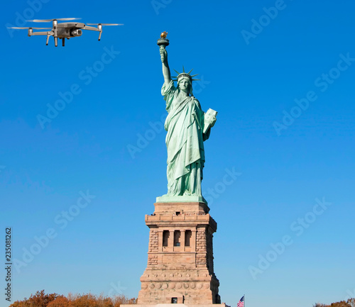 Fotobehang New York City Drone flying over Statue of Liberty, New York