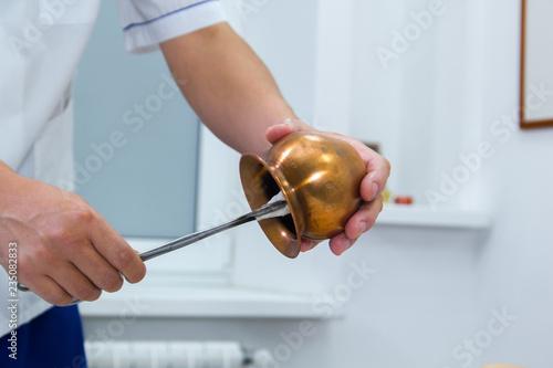 Fotografie, Obraz  A woman taking a treatment of alternative medicine