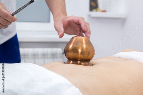 Valokuva  A woman taking a treatment of alternative medicine