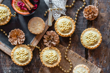 Traditional Christmas Mince Pies And Mulled Wine On Wooden Table - Top View