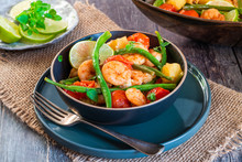 Thai Prawns With Pineapple And Green Beans On Rustic Wooden Table