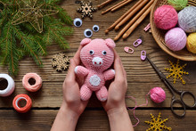 Pink Pig, Symbol Of 2019. Happy New Year. Crochet Toy For Child. On Table Threads, Needles, Hook, Cotton Yarn. Handmade Crafts On Holiday With Your Own Hands. DIY Concept.