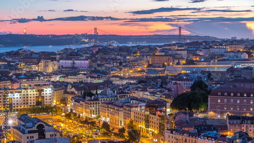 Fotobehang Lavendel Lisbon after sunset aerial panorama view of city centre with red roofs at Autumn day to night timelapse, Portugal