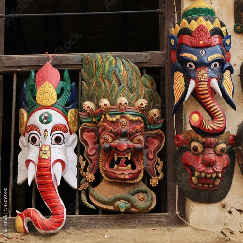 Colorful timber masks representing Hindu gods. Kathmandu, Nepal..