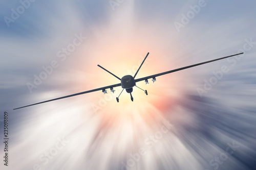 Unmanned military drone uav flying at high speed in the clouds