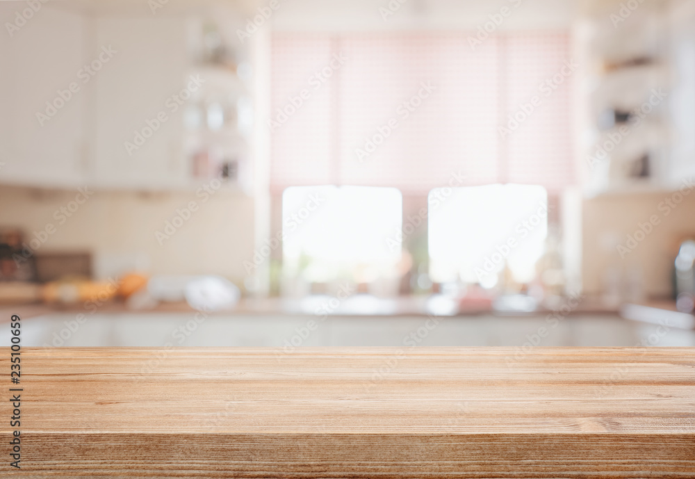 Fototapeta Empty tabletop over defocused kitchen with copy space