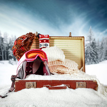 Retro Old Suitcase In Snow And Winter Landscape