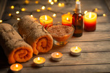 Composition of spa treatment on a wooden background, relaxation and beauty with space for designer