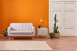 canvas print picture - Living room sofa with orange background and white classic door.