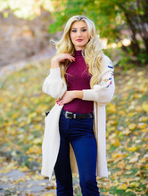 Woman Wear Long Knitted Cardigan While Walk In Park. Fall Fashion Cozy Cardigan. Feel So Warm And Comfortable. Autumn Fashionable Cardigan. Girl Stylish Outfit With Soft Wool Or Cashmere Cardigan