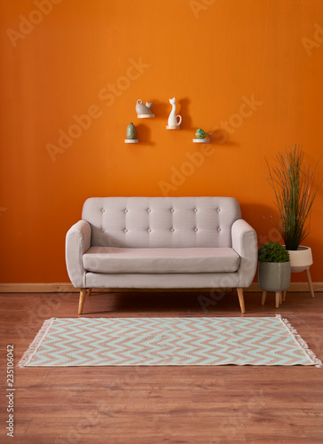 orange room background wall grey sofa carpet and vase of plant interior buy this stock photo and explore similar images at adobe stock adobe stock background wall grey sofa carpet