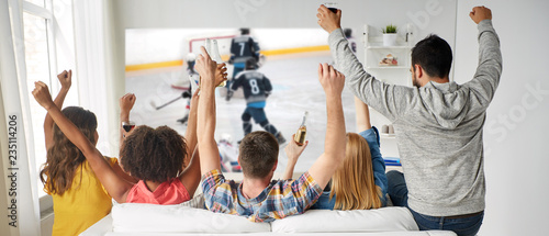 friendship, sport and leisure concept - happy friends drinking beer and watching Wallpaper Mural