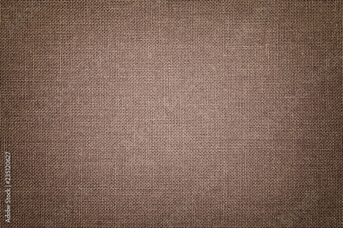 Fotografiet  Brown background from a textile material with wicker pattern, closeup