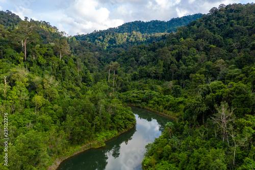 Fototapeta Aerial view of dense, mountainous tropical rainforest in Thailand