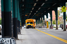 A School Bus Is Passing Under ...