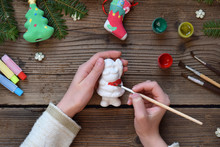 Painting Christmas Toys From Porcelain For Decorations. Making Clay Toy With Your Own Hands. Children's DIY Concept. Handmade Crafts On Holiday. Master Class Of Art
