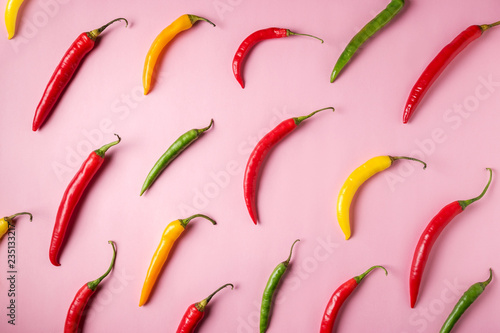 Door stickers Hot chili peppers Creative layout of chili pepper on pink background. Minimal food concept.