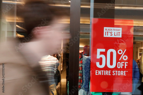 A man walks by an advertisement during the Black Friday