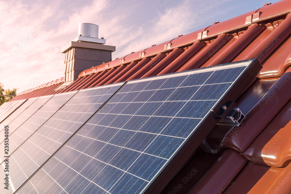 Fototapety, obrazy: solar panesl or photovoltaic plant on the roof of a house